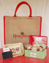 Gift bag with gluten free cakes and tin