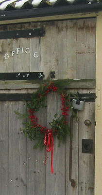 Homemade Christmas wreath hanging on stable door