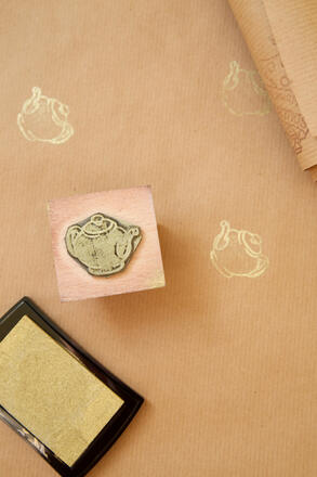 Small stamp with teapot design