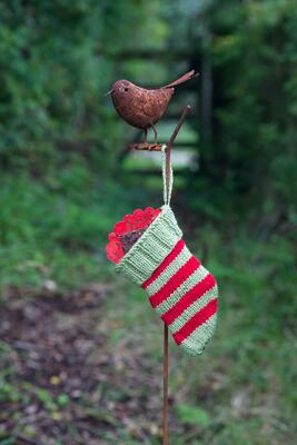 Striped Christmas stocking hanging in garden