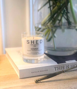Shed Soy Candle on book