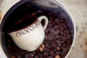 chocolate buttons in vintage china mug