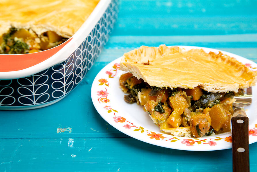 Butternut squash, stilton and spinach pie cut on plate