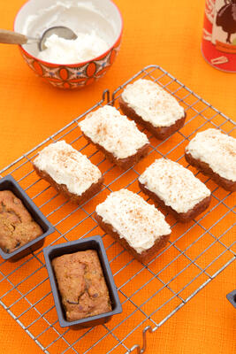Gluten free and dairy free mini carrot cake loaves on wire rack