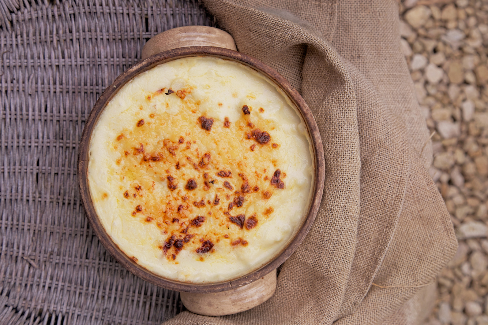 Gluten free cauliflower cheese in dish