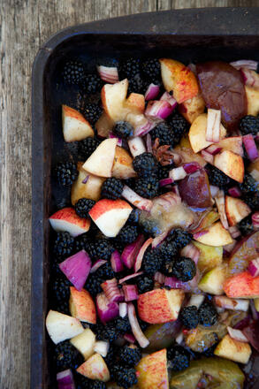 Chopped apples and blackberries on tray