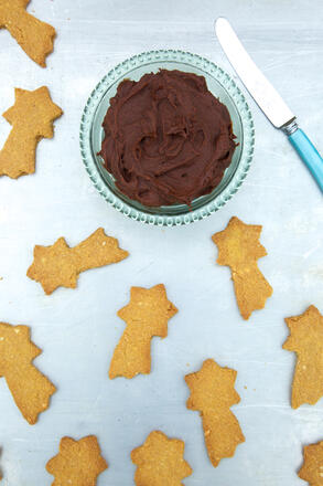 Shortbread stars and chocolate dip on baking tray