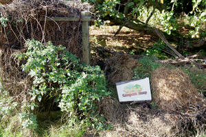 Compost heap at honeybuns with sign
