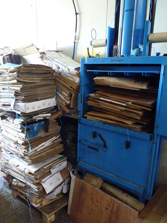 compressing machine recycling cardboard at Honeybuns