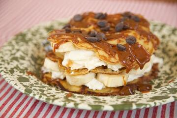 Gluten free pancakes with cream and banana