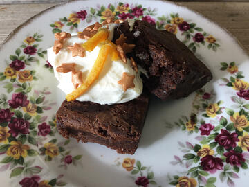 Gungy brownie in vintage bowl with ice cream