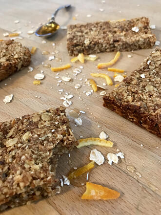 Vegan date and orange flapjacks on wooden chopping board