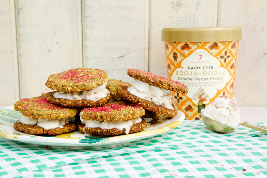 cookieice cream sandwiches with scoop and tub of ice cream
