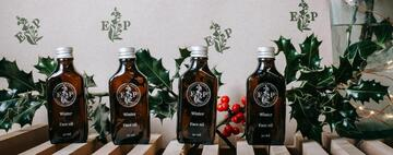 Brown glass bottles with Enchanted plants etched on