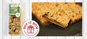 Mincemeat Crumble Slice cake slice in packaging and traybake on wood background