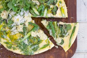 Asparagus and spinach frittata on wooden board