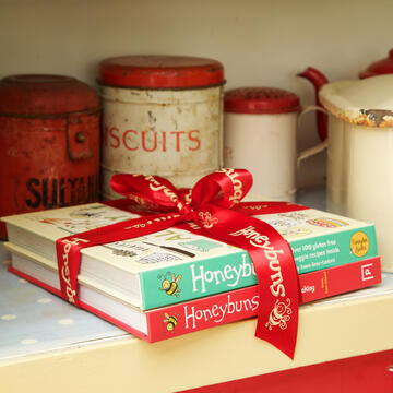 Two Honeybuns gluten free baking books tied up in ribbon