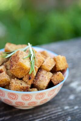 Crispy gluten free croutons with rosemary sprig