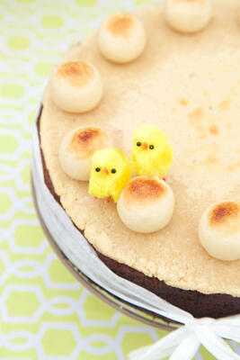 Gluten free Easter Simnel cake with marzipan topping and balls, on a vintage glass cake stand