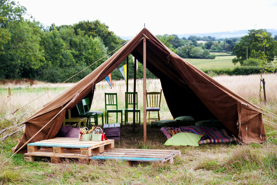 Vintage scout tent for festival with bunting