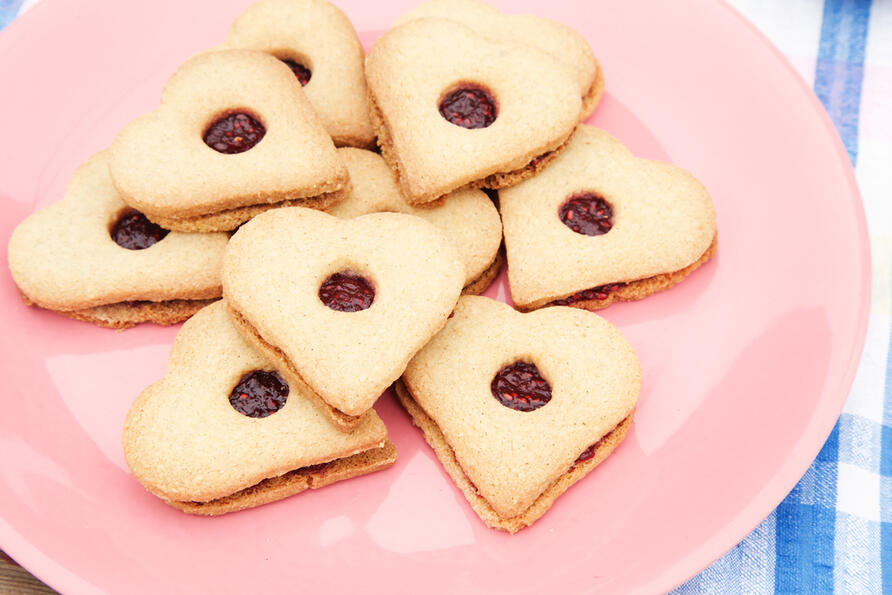 Gluten free heart shaped biscuits on pink plate