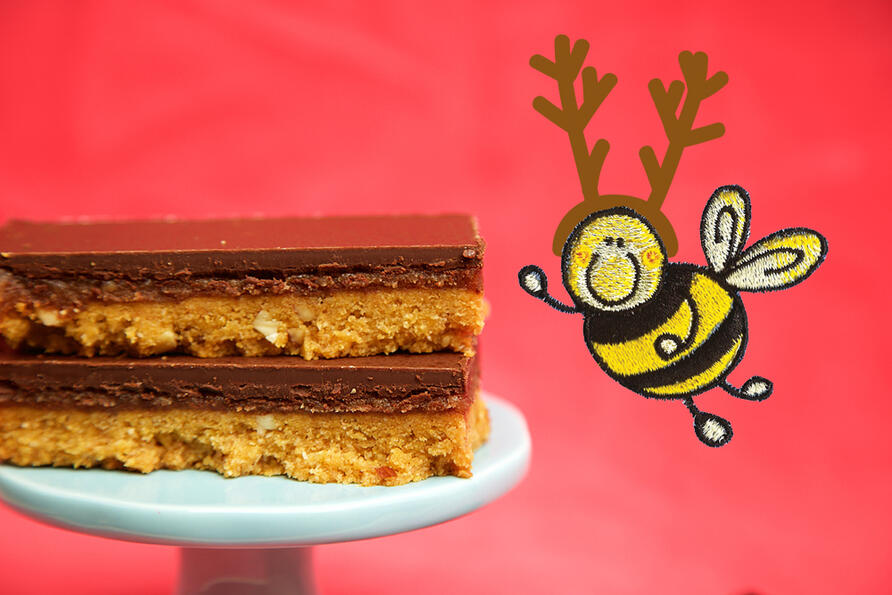 Stack of Millionaire's Shortbread on cake stand with christmas bee