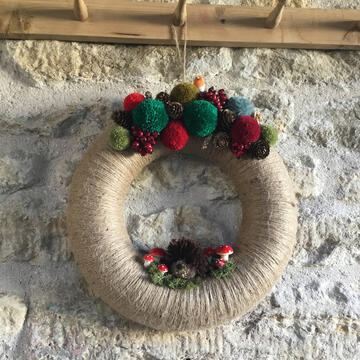 christmas wreath with handmade pompoms and mushrooms