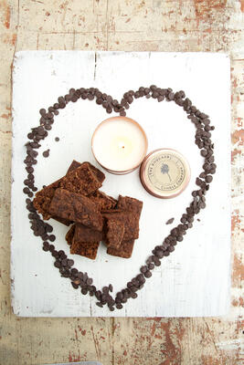 Cakes and candle in chocolate drop heart