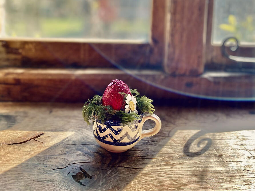 vintage teacup planted with Spring flowers, moss and mini easter eggs