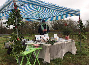Market stall with cakes and gifts for sale