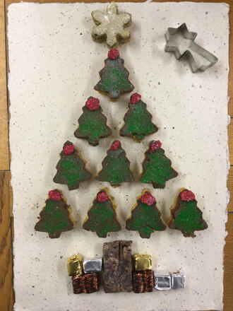 cake cut out in christmas tree shape with cookie cutter