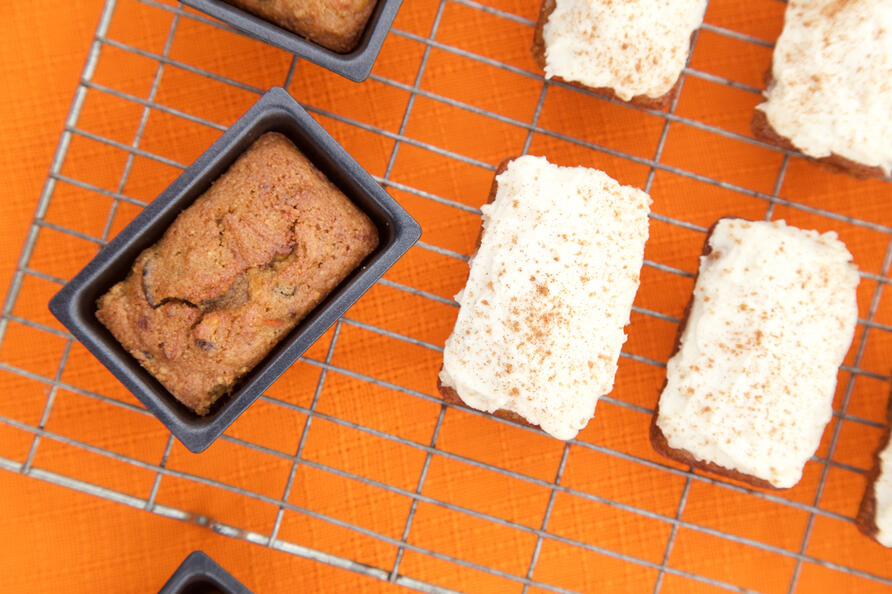 Mini gluten free carrot cakes on wire cooling rack