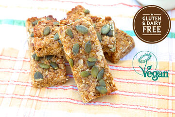 Vegan Oaty Apricot Bar topped with pumpkin seeds