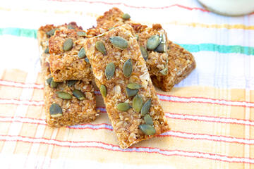 Gluten free and vegan apricot flapjack topped with pumpkin seeds