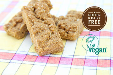 Vegan and gluten free coconut flapjacks on patterned cloth