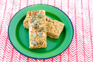 Apricot and coconut flapjacks on green plate