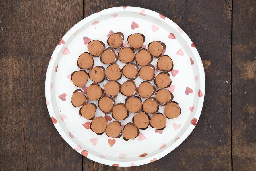 Valentine's chocolate truffles on heart platter