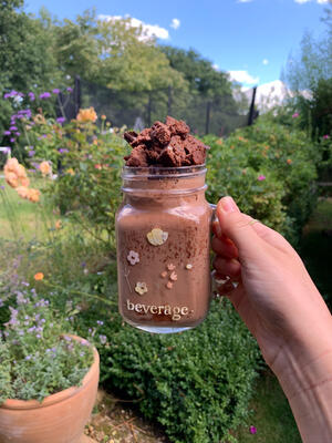 Vegan & gluten free Dark Chocolate Brownie ice cream float in a glass