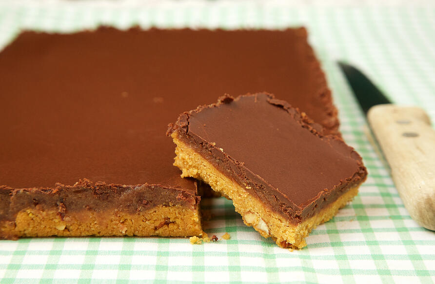Millionaire's Slice traybake with slice cut into it.