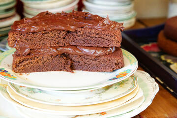 chocolate cake filled and iced with rich chocolate ganache, on pretty vintage plate