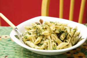Wild garlic pesto pasta in bowl at table
