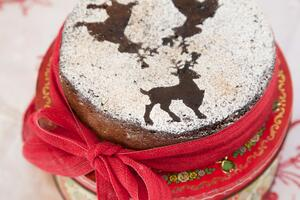 Chocolate Christmas cake tied with red ribbon