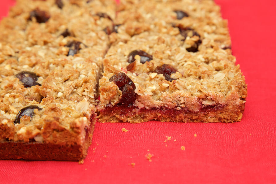 Gluten and dairy free and vegan Cherry Crumble bar traybake perfect for foodservice