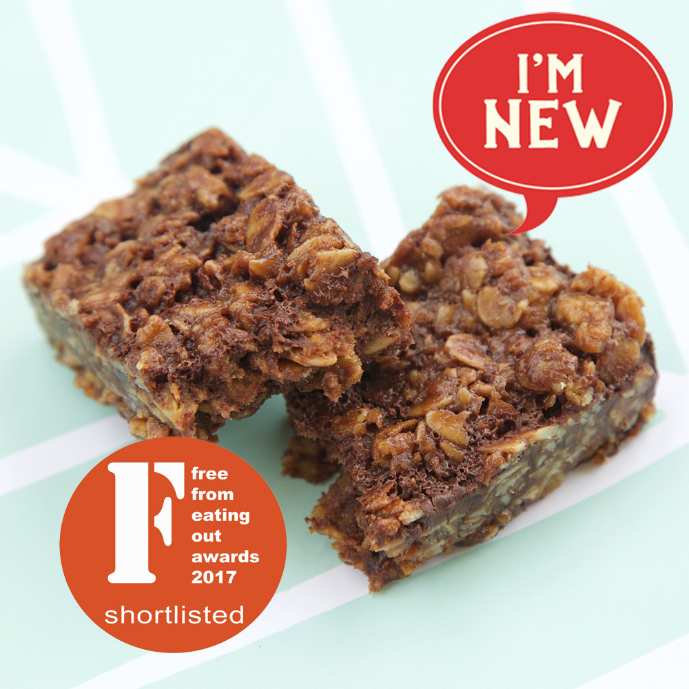 Stacked Oaty Coconut Bars with dark chocolate, a Free From Eating Out Award finalist