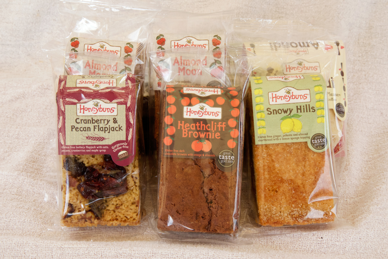 Trio of award winning cakes in packaging