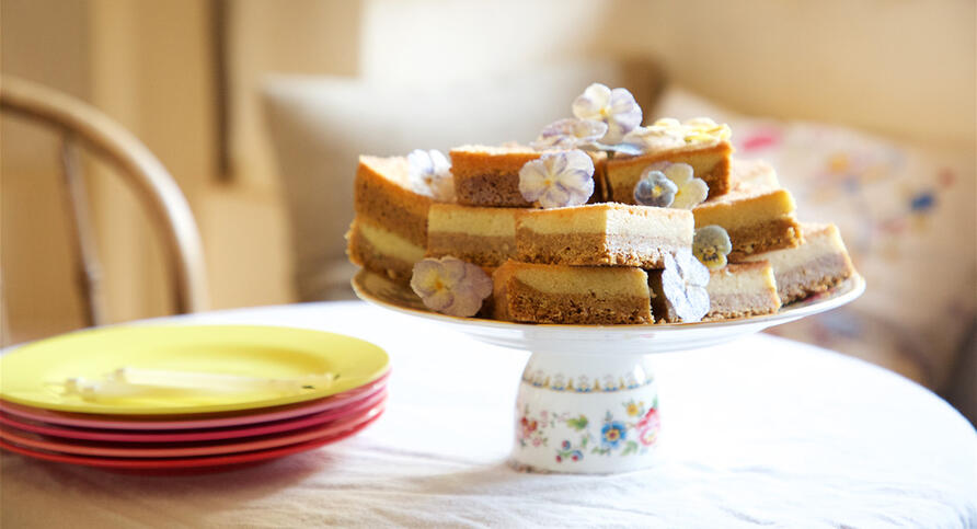 Stack of cake slices on vintage cake stand