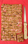 New Oaty Raspberry Bar traybake with drizzled icing on top