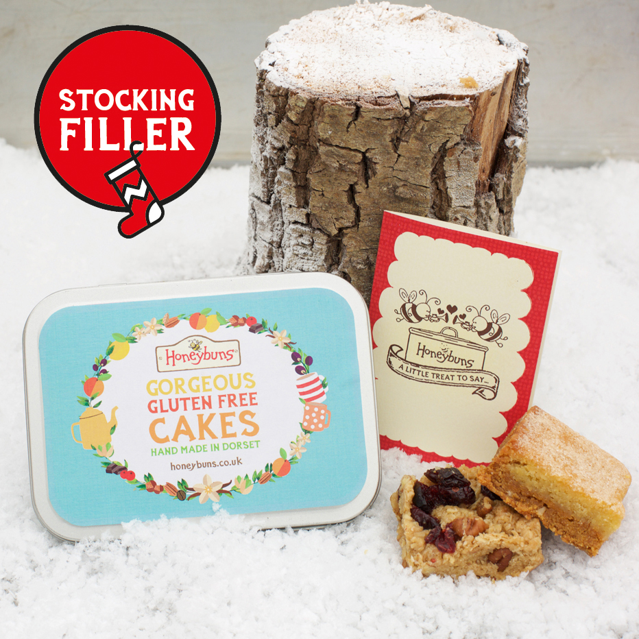 Christmas flavoured gluten free cakes in a cute little stocking filler tin with a gift card.