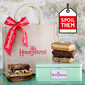 Festive flavours gluten free cakes in a gift tin and Honeybuns hessian bag