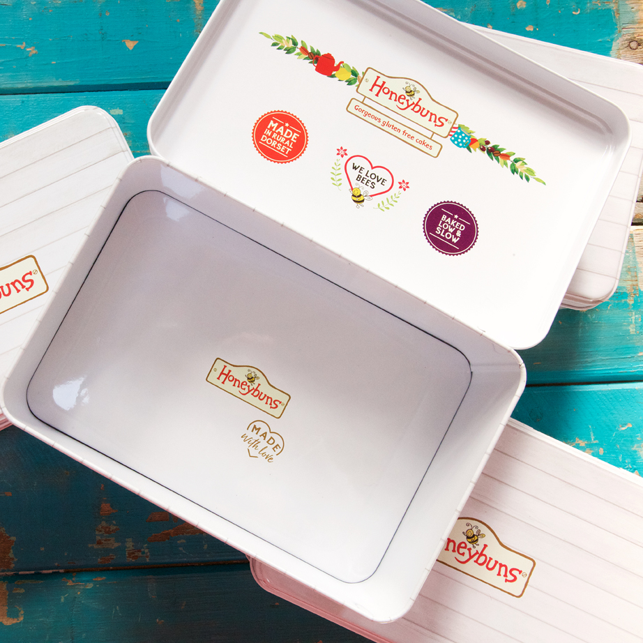 Gorgeous gift tin to keep your gluten free and vegan friendly cakes in. Order online for UK delivery.